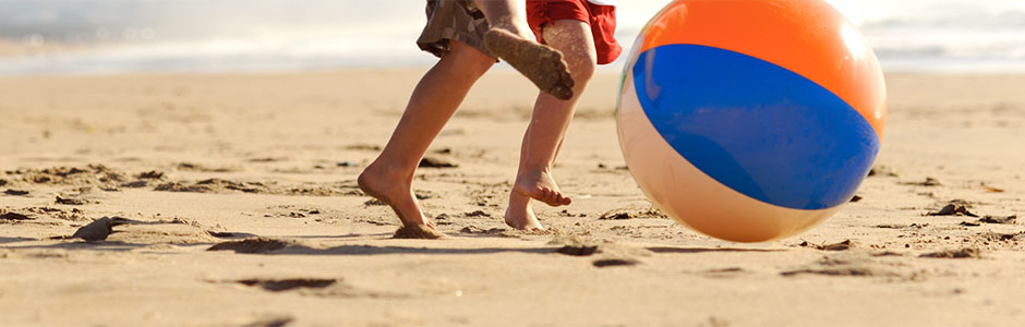 kids kicking beach ball
