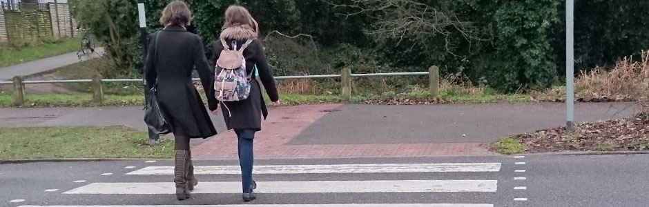 road safety mother and daughter crossing road